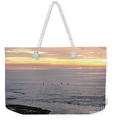 Weekender Tote Bag featuring the photograph Sunset Surfing by Carol  Bradley