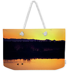 Weekender Tote Bag featuring the photograph Sunset Swim by Sue Collura