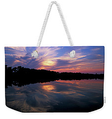 Weekender Tote Bag featuring the photograph Sunset Swirl by Steve Stuller