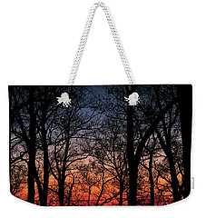 Weekender Tote Bag featuring the photograph Sunset Through The Trees by Mark Dodd