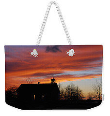 Sunsetting Behind The Historic Schoolhouse. Weekender Tote Bag