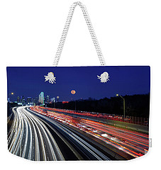Weekender Tote Bag featuring the photograph Super Moon And Dallas Texas Skyline by Robert Bellomy