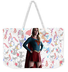 Weekender Tote Bag featuring the mixed media Supergirl Splash Super Hero Series by Movie Poster Prints