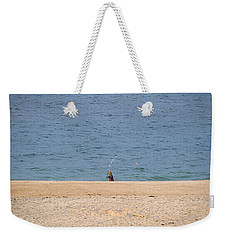 Weekender Tote Bag featuring the photograph Surf Caster by  Newwwman