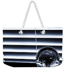 Weekender Tote Bag featuring the photograph Suspended by Eric Christopher Jackson