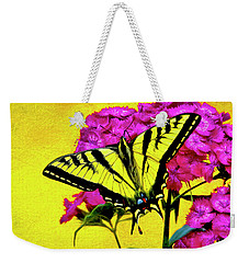 Weekender Tote Bag featuring the digital art Swallow Tail Feeding by James Steele