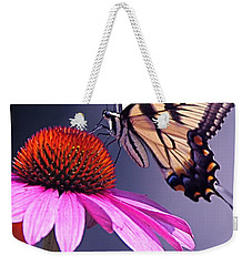 Weekender Tote Bag featuring the photograph Swallowtail And Coneflower by Byron Varvarigos