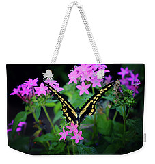 Weekender Tote Bag featuring the photograph Swallowtail Butterfly Rests On Pink Flowers by Toni Hopper
