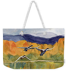 Weekender Tote Bag featuring the painting Swan Lake Revisited by Kris Parins
