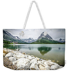Weekender Tote Bag featuring the photograph Swiftcurrent Lake by Margaret Pitcher