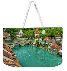 Weekender Tote Bag featuring the photograph Swimming The River Aare , Bern  by Connie Handscomb