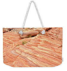 Weekender Tote Bag featuring the photograph Swirling Sandstone Color In Valley Of Fire by Ray Mathis