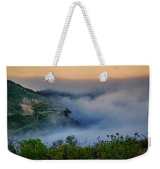 Weekender Tote Bag featuring the photograph Switchbacks In The Clouds by Joseph Hollingsworth