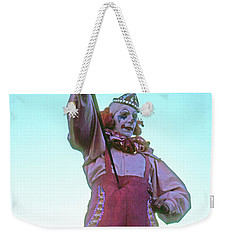 Weekender Tote Bag featuring the photograph Sword Swallower by Laurie Stewart