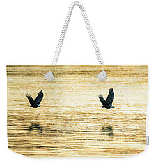 Synchronized Bald Eagles At Dawn 2 Of 2 Weekender Tote Bag by Jeff at JSJ Photography