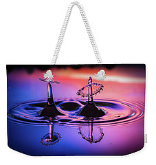 Weekender Tote Bag featuring the photograph Synchronized Liquid Art by William Lee