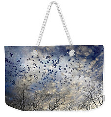 Weekender Tote Bag featuring the photograph Taken Flight by Jan Amiss Photography