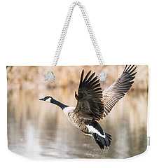 Weekender Tote Bag featuring the photograph Taking Flight by Steven Santamour