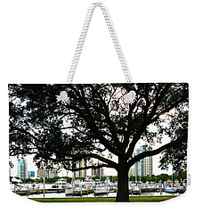 Weekender Tote Bag featuring the photograph Tampa Shoreline And Skyline Through Tree by Marilyn Hunt