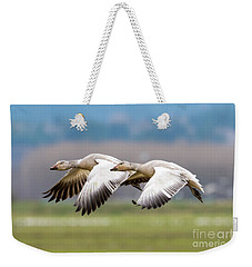 Weekender Tote Bag featuring the photograph Tandem Glide by Mike Dawson