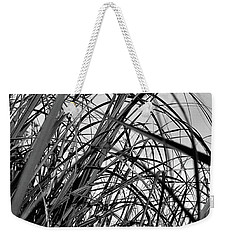 Weekender Tote Bag featuring the photograph Tangled Grass by Susan Capuano