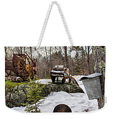 Weekender Tote Bag featuring the photograph Tapping A Maple Sugar Tree by Betty Pauwels