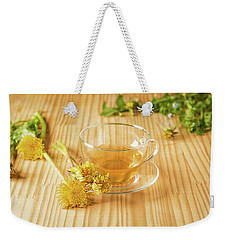 Weekender Tote Bag featuring the photograph Taraxacum Tisane by Traven Milovich