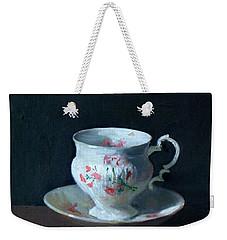 Teacup And Saucer On Dark Background Weekender Tote Bag