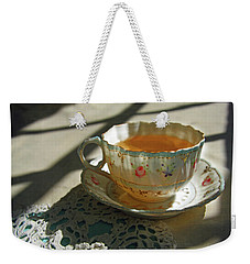 Weekender Tote Bag featuring the photograph Teacup On Lace by Brooke T Ryan