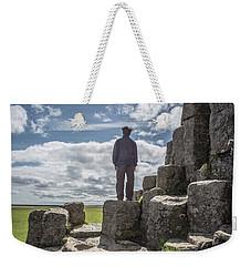 Weekender Tote Bag featuring the photograph Teen Boy Standing On Basalt Rocks by Edward Fielding