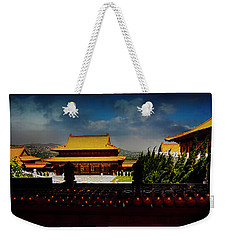 Weekender Tote Bag featuring the photograph Temple Candles by Joseph Hollingsworth