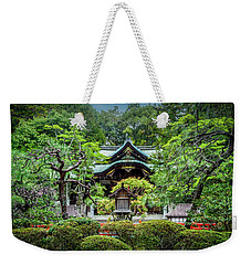 Weekender Tote Bag featuring the photograph Temple In The Rain by Rikk Flohr