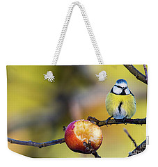 Weekender Tote Bag featuring the photograph Tempting by Torbjorn Swenelius