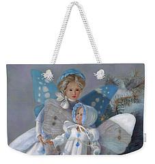 Weekender Tote Bag featuring the painting Tenderness Snow Fairies by Nancy Lee Moran