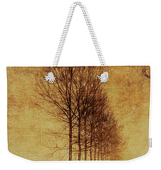 Weekender Tote Bag featuring the mixed media Textured Eerie Trees by Dan Sproul