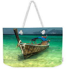Weekender Tote Bag featuring the photograph Thai Longboat  by Adrian Evans