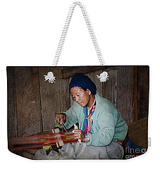 Weekender Tote Bag featuring the photograph Thai Weaving Tradition by Heiko Koehrer-Wagner