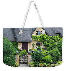 Weekender Tote Bag featuring the photograph Thatch Roof Cottage Home by Brian Jannsen