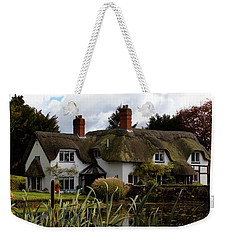 Weekender Tote Bag featuring the photograph Thatched Cottage by Baggieoldboy