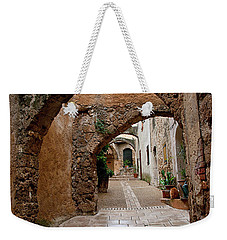 Weekender Tote Bag featuring the photograph The Archways Of Villecroz by Jacqi Elmslie