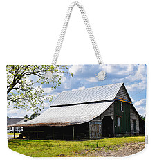 Weekender Tote Bag featuring the photograph The Barn In Spring by Linda Brown