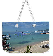 Weekender Tote Bag featuring the photograph The Beach At Cannes by Allen Sheffield
