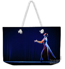 Weekender Tote Bag featuring the photograph The Beautiful Ballerina Dancing In Blue Long Dress by Dimitar Hristov