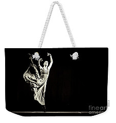 Weekender Tote Bag featuring the photograph The Beautiful Ballerina Dancing In Long Dress by Dimitar Hristov