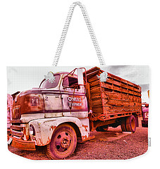 Weekender Tote Bag featuring the photograph The Beauty Of An Old Truck by Jeff Swan