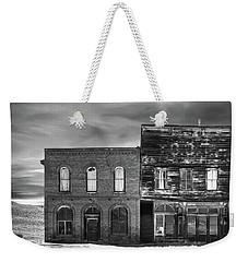 The Boot Building Weekender Tote Bag by Marius Sipa