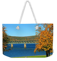 Weekender Tote Bag featuring the photograph The Bridge by Rick Morgan