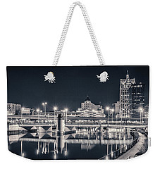 Weekender Tote Bag featuring the photograph The Bright Dark Of Night by Bill Pevlor