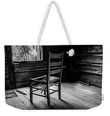 Weekender Tote Bag featuring the photograph The Broken Chair by Doug Camara