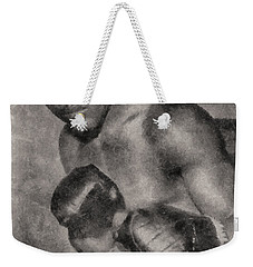 Weekender Tote Bag featuring the photograph The Brown Bomber by Joseph Hollingsworth